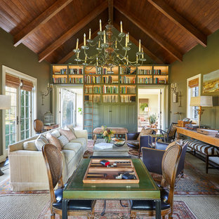 Inspiration for a country enclosed family room remodel in Tampa with green walls and no fireplace