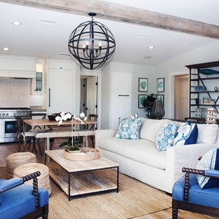 Small beach style open concept family room in Orange County.