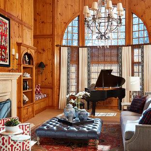 ミネアポリスの広いトラディショナルスタイルのおしゃれなファミリールーム (カーペット敷き、標準型暖炉、石材の暖炉まわり、ベージュの床、ミュージックルーム、茶色い壁) の写真