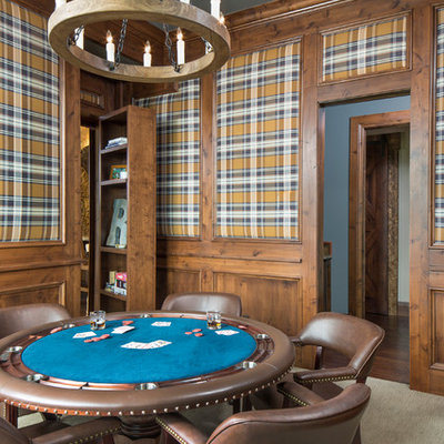 Game room - rustic enclosed carpeted game room idea in Denver with multicolored walls