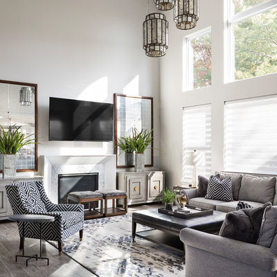 Inspiration for a transitional open concept gray floor family room remodel in Other with white walls, a standard fireplace, a stone fireplace and a wall-mounted tv
