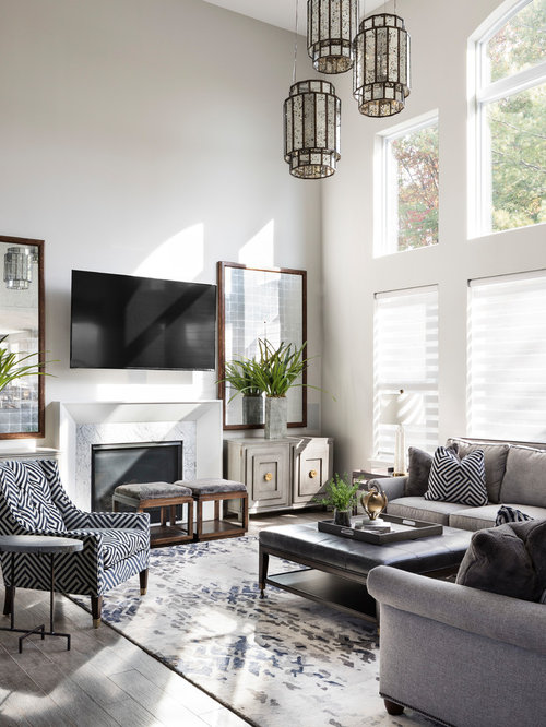 inspiration for a transitional open concept gray floor family room remodel in other with white walls - Transitional Design Ideas