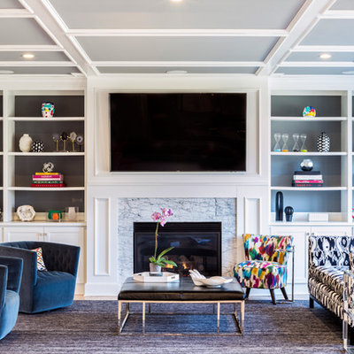 Example of a large transitional open concept light wood floor and brown floor family room design in New York with gray walls, a standard fireplace, a wall-mounted tv and a stone fireplace