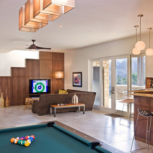Example of a trendy open concept game room design in Austin with white walls