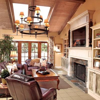 Family room - eclectic family room idea in Los Angeles with a stone fireplace