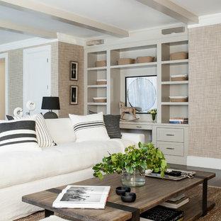 Ejemplo de sala de estar abierta, clásica renovada, extra grande, con paredes beige, suelo de madera oscura, chimenea tradicional, marco de chimenea de piedra y televisor colgado en la pared
