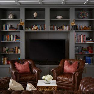 Foto de sala de estar clásica, sin chimenea, con paredes grises y suelo de madera oscura