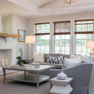 Inspiration for a transitional family room remodel in Baltimore with gray walls, a standard fireplace and a brick fireplace