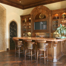 Mediterranean Family Room by Quality Woodworks Inc.