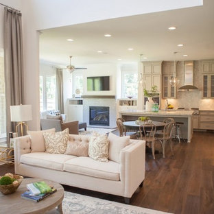 Mid-sized elegant open concept dark wood floor family room library photo in Atlanta with beige walls, a standard fireplace, a stone fireplace and a tv stand