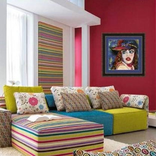 Example of a mid-sized eclectic open concept ceramic floor family room design in New York with red walls, no fireplace and no tv