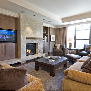 Example of a trendy family room design in Vancouver with a stone fireplace