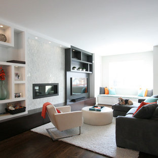 Mid-sized modern open concept family room in Chicago with beige walls, dark hardwood floors, a ribbon fireplace, a tile fireplace surround and a wall-mounted tv.