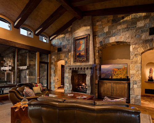 Example Of A Southwest Enclosed Medium Tone Wood Floor Family Room Design  In Phoenix With A