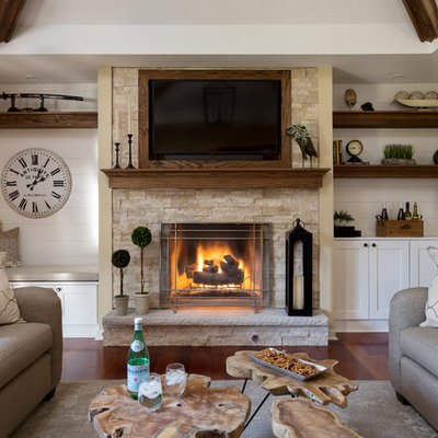 Mid-sized mountain style open concept medium tone wood floor and brown floor family room photo in Chicago with beige walls, a standard fireplace, a stone fireplace and a wall-mounted tv