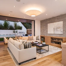 Contemporary Family Room by Building Solutions and Design, Inc