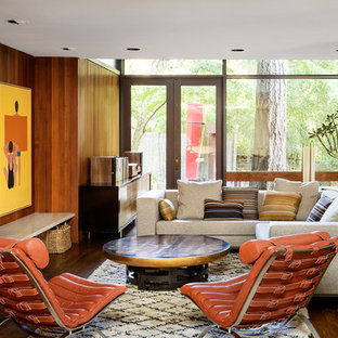 Family room - midcentury modern medium tone wood floor family room idea in Portland with white walls and a standard fireplace