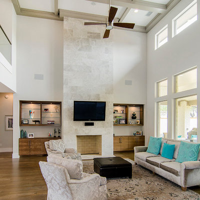 Inspiration for a contemporary open concept medium tone wood floor family room remodel in Dallas with a standard fireplace and a wall-mounted tv