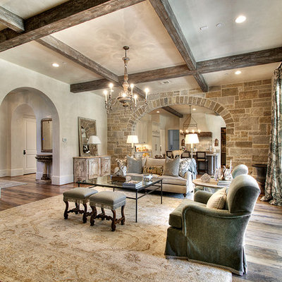 Family room - traditional medium tone wood floor family room idea in Houston with beige walls