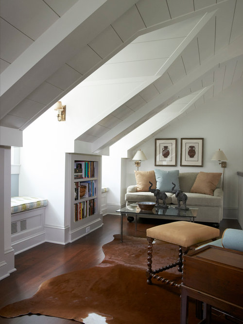 Traditional family room idea in New York with white walls