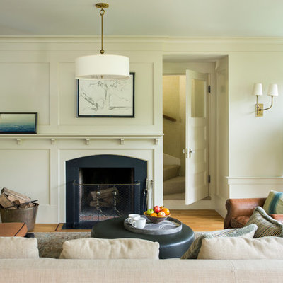 Large ornate open concept light wood floor family room photo in Boston with beige walls, a standard fireplace and a wood fireplace surround