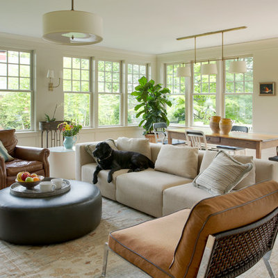 Inspiration for a mid-sized victorian open concept light wood floor family room remodel in Boston with beige walls and no tv