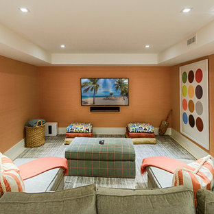 Inspiration for a beach style enclosed carpeted and gray floor family room remodel in Boston with orange walls and a wall-mounted tv