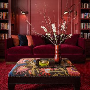 Inspiration pour une salle de séjour avec une bibliothèque ou un coin lecture design de taille moyenne et fermée avec un mur rouge et moquette.