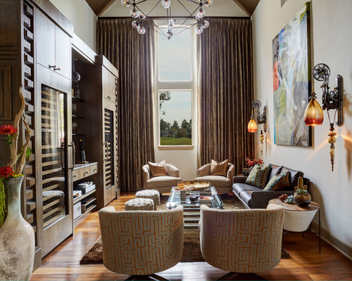 Family room eclectic medium tone wood floor and brown floor family room idea in houston