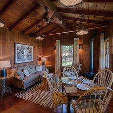 Farmhouse Family Room by JMA (Jim Murphy and Associates)