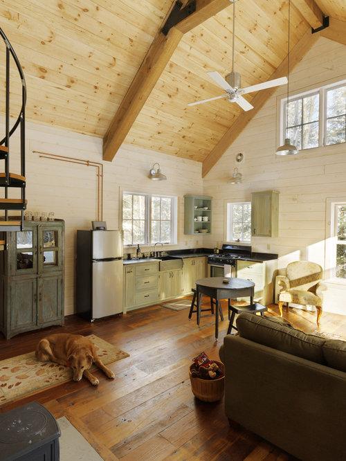 Example Of A Mountain Style Open Concept Medium Tone Wood Floor Family Room  Design In Burlington