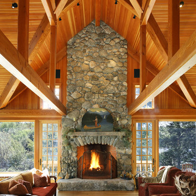 Example of a mountain style open concept family room design in Boston with a standard fireplace and a stone fireplace