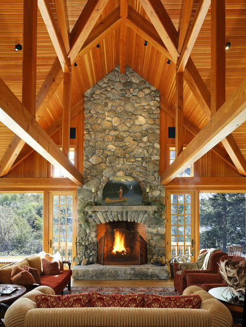 Example of a mountain style open concept family room design in Boston with  a standard fireplace