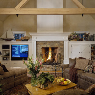 Inspiration for a rustic family room remodel in New York with beige walls, a standard fireplace, a stone fireplace and a media wall