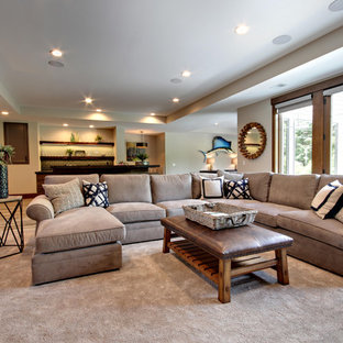 Example of a transitional open concept carpeted and beige floor family room design in Grand Rapids with beige walls