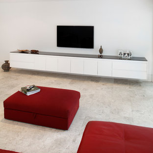 Example of a minimalist travertine floor family room design in Sydney with white walls, no fireplace and a wall-mounted tv