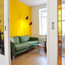 Eclectic Family Room by ijzersterk interieurontwerp