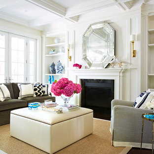 Inspiration for a transitional family room remodel in Toronto with a wood fireplace surround