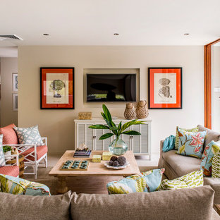 Inspiration for a beach style family room remodel in Brisbane with beige walls and a wall-mounted tv