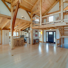 Traditional Family Room by Heirloom Timber Framing
