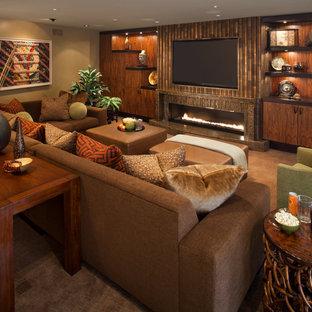 Idée de décoration pour une grande salle de séjour ethnique ouverte avec un mur marron, moquette, une cheminée ribbon, un manteau de cheminée en carrelage, un téléviseur encastré et un sol marron.