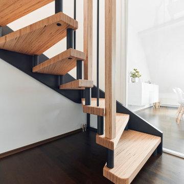 BauBuche und Rohstahleffekt mit passendem Esstisch und Sitzbank