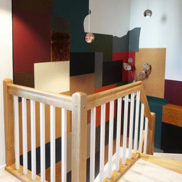 Designerferienwohnung mit Ledertapete im Treppenaufgang