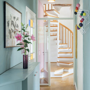 Design ideas for a mid-sized midcentury hallway in Cologne with blue walls and light hardwood floors.