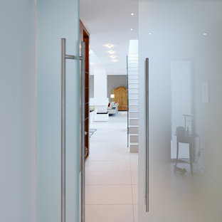 Hallway - huge contemporary porcelain floor and white floor hallway idea in Other with white walls