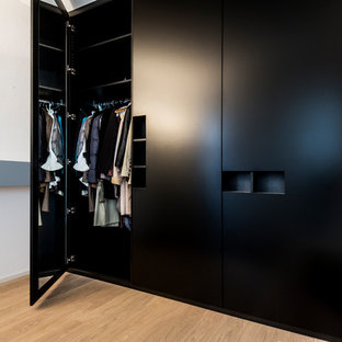 Inspiration for a large contemporary light wood floor and beige floor hallway remodel in Munich with white walls