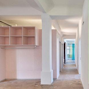 На фото: коридор среднего размера в стиле модернизм с розовыми стенами, бетонным полом, серым полом, кессонным потолком и деревянными стенами