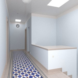 Inspiration for a small contemporary ceramic floor and multicolored floor hallway remodel in Essen with blue walls