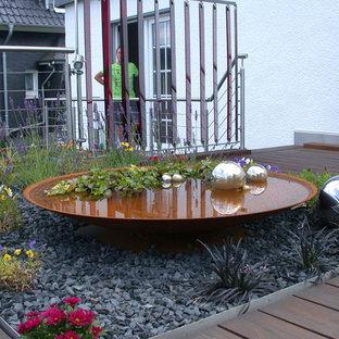 Ispirazione per un giardino design sul tetto con pedane