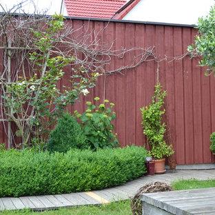 Jardin avec une terrasse en bois ou composite Nuremberg : Photos et ...